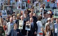 Путин с портретом отца возглавил марш